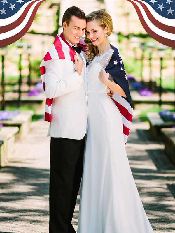 a bride and groom posing together with an american flag